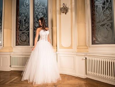 female wearing white mesh-top strapless sweetheart-neckline a-line wedding dress