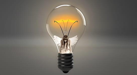girl with wings inside light bulb illustration