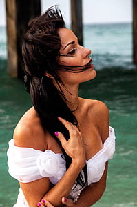 shallow focus photography of woman in white off-shoulder top
