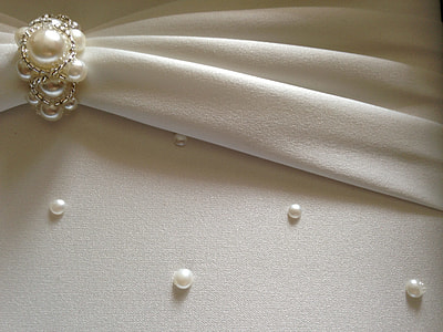 white pearl studded cloth