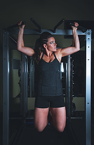 woman using gym exercise equipment