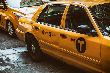 A shot of a classic yellow New York Taxi, image captured in Manhattan, NYC with a Canon 5D