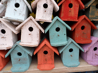 wooden birdhouse lot during daytime
