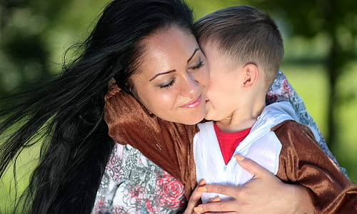 woman hugging boy