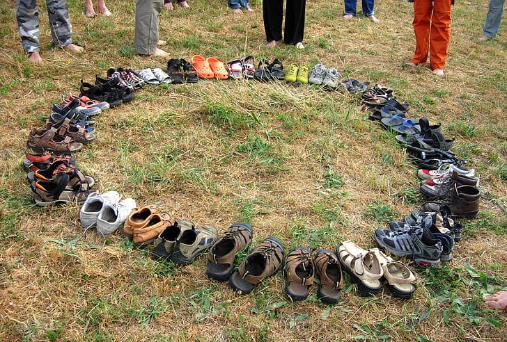 assorted footwear lot on field