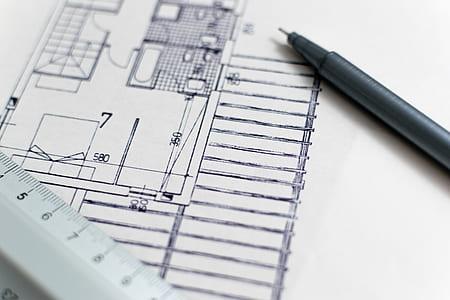 black ballpoint pen on house blueprint
