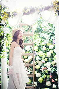 photo of woman wearing dress near brown ladder
