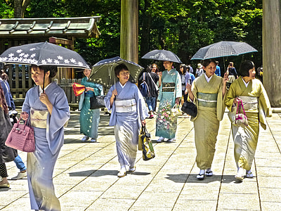 geisha women with umbrellas