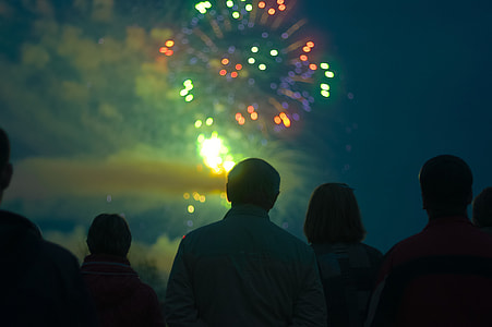group of people watching firework display during nighttime