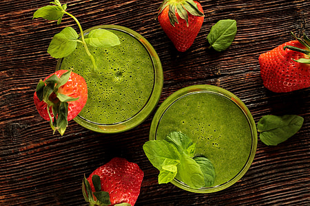 Green smoothie drink with strawberries