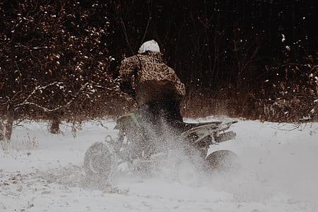 person rides ATV during daytime
