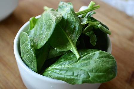green leaves on white ceramic bowl
