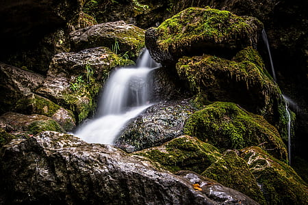 low exposure photo of waterfalls