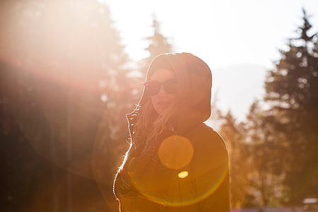 woman wearing brown hoodie during sunshine