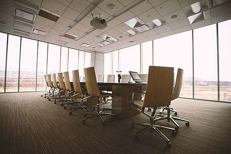 empty office with table and rolling chairs