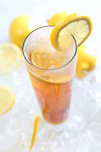 yellow citrus and clear glass cup