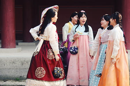 group of women wearing traditional dresses