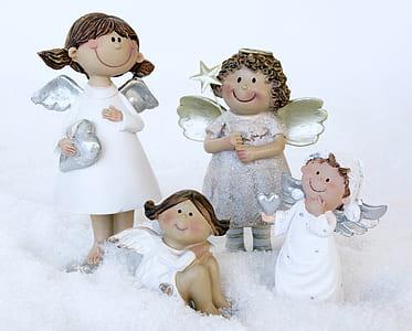 four angel figurines