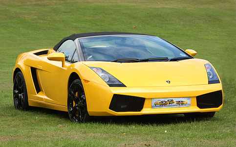 photograph of yellow sports car
