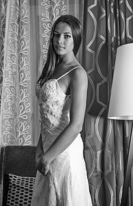 black and white photo of woman in spaghetti strap floral dress
