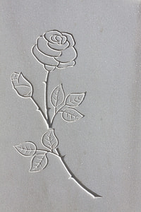 closeup photography of rose flower carved panel
