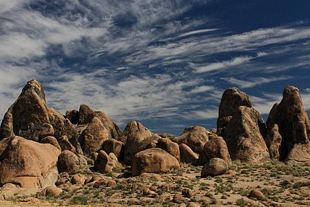 brown rock formation under blue sky at daytime