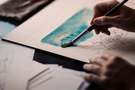 person draw on white printer paper