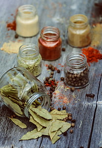 clear glass mason jars filled with assorted spices