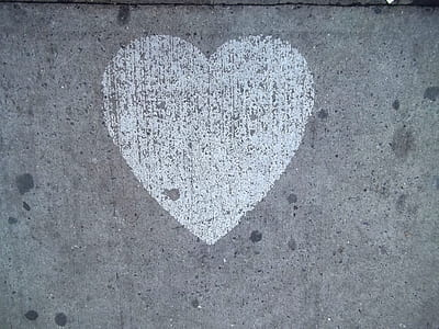 gray and white heart graffiti in wall