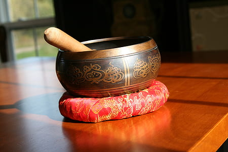 brown mortar and pestle on brown wooden table