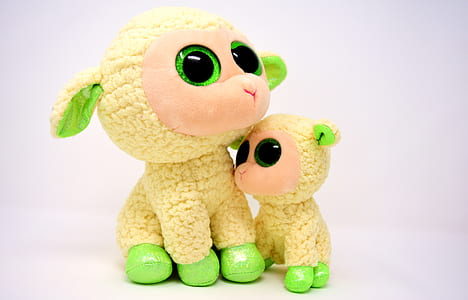 two yellow-and-green sheep plush toys