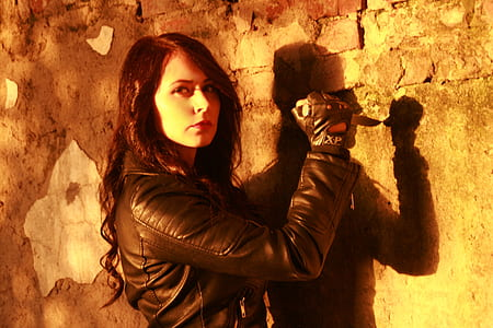 woman in leather jacket holding knife