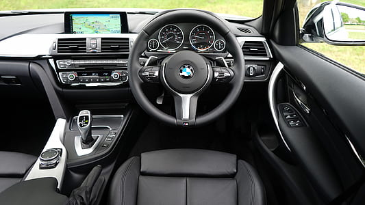 photo of black BMW steering wheel