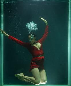 women in red dress on underwater