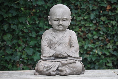 meditating monk statue on platform