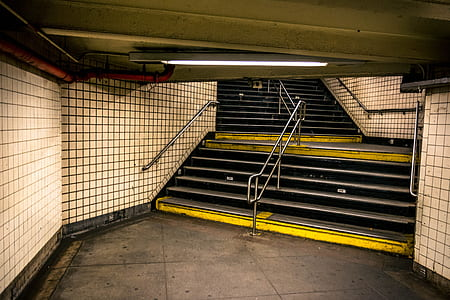 yellow and black metro station stair
