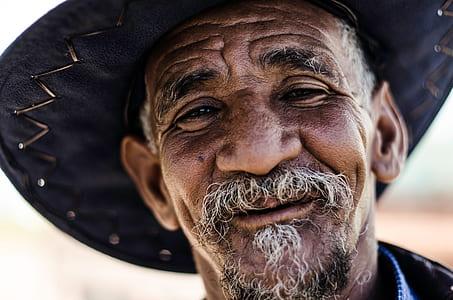 close view of man wearing black sombrero