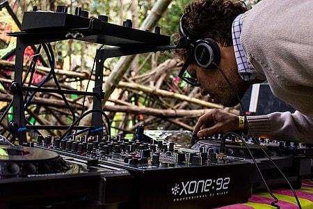 man controlling Xone 92 DJ turntable