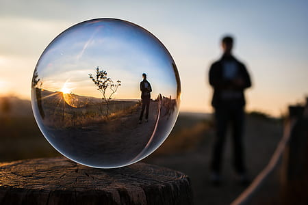 water drop photography of man standing near tree
