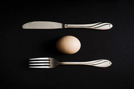 Overhead shot of egg and knife and fork
