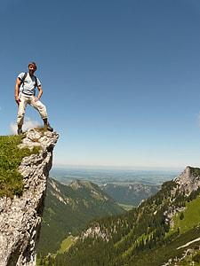 man wearing backpack on mountain