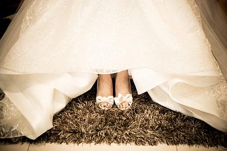 bride wearing white peep-toe heeled shoes
