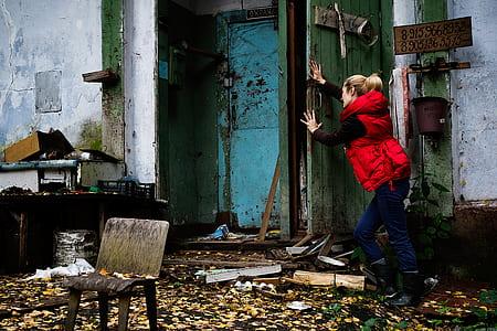 woman pushing door
