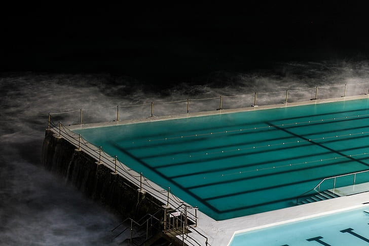 olympic size swimming pool near body of water