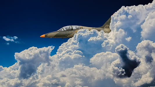 close-up photo of aircraft near clouds