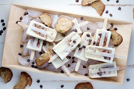sliced breads and ice cream on brown wooden food tray