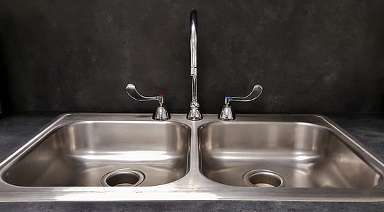 silver double sink with gooseneck faucet