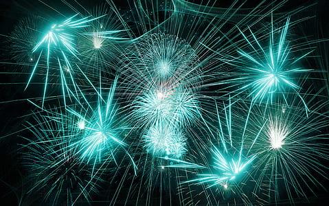 teal fireworks wallpaper