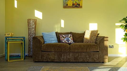 brown fabric 2-seat sofa near brown wicker decor