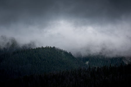 green mountain under the cloudy sky during daytime